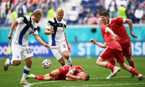 Dmitri Barinov of Russia goes down injured as Paulus Arajuuri of Finland looks to play on.