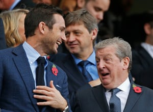 Former Chelsea player Frank Lampard and England manager Roy Hodgson enjoy the match.