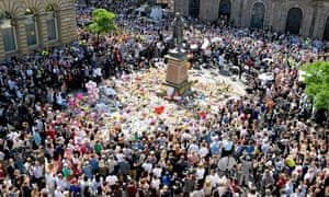 Members of the public observe a national minute's silence in remembrance of all those who lost their lives in the Manchester Arena attack.