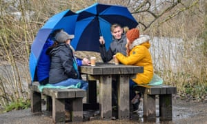 People chat over a coffee in Bute Park in Cardiff, Wales, where stay at home restrictions were eased today.