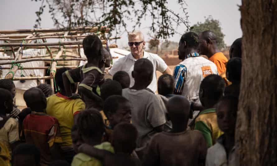 Jan Egeland, secretary general of the Norwegian Refugee Council, talks to children in a camp for internally displaced people in Barsalogho in northern Burkina Faso.