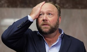 The radio host and conspiracy theorist Alex Jones speaks to the media outside a Senate intelligence committee hearing with top executives from Twitter and Facebook on Wednesday.