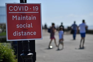 Southend-on-Sea, England Signs advise beachgoers arriving at the seafront to maintain physical distancing rules