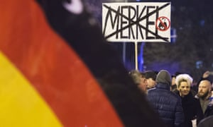 People at an anti-immigration rally in Erfurt organised by the AfD party