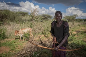 A Pokot herder with a traditional home made bow and arrow used for protecting livestock