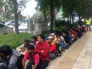 Rohingya workers in Kuala Lumpur, Malaysia are detained after they try to join a protest near the Myanmar embassy.
