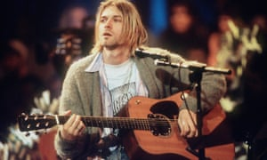 Cobain unbuttoned: wearing the £93,000 cardigan during the recording of MTV Unplugged in 1993.