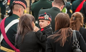 The shooting victim's son Marcus Cirillo (C), is carried by an unidentified person as he arrives at Christ's Church Cathedral for the funeral of his father, Canadian soldier Nathan Cirillo, in Hamilton, Canada