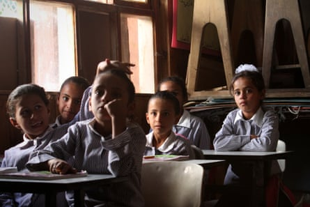Children in Khan al-Ahmar attend a school lesson
