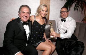 Jim Gianopulos, chairman and CEO of Fox, with winner Jennifer Lawrence and writer/director David O. Russell at Fox's party