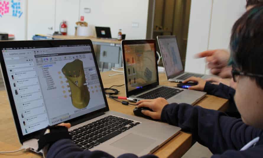 Child using 3D design program.