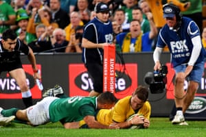Bernard Foley of Australia goes over for the first try of the game.