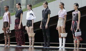 LongchampModels meandered along the edge of the giant pond at the Lincoln Center's Hearst Plaza. Creative director Sophie Delafontaine recalled the colourful artwork of Judy Chicago and a wardrobe that takes a woman from dawn-to-dust. Blurring decades from the 70s to the 90s. Crop tops were paired with transparent skirts and floral applique. Boxy leather jackets were teamed with knitted two-piece sets. Each look styled with a neoprene sock boot, Sporty morphed with bohemian sprang to mind.