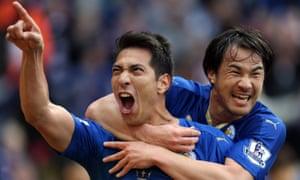 Leonardo Ulloa celebrates with Shinji Okazaki after scoring to make it 2-0.