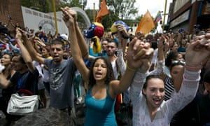 Demonstrators sing Venezuela's national anthem during a protest against the Maduro government.