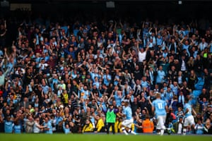 Fans of Manchester City celebrate.