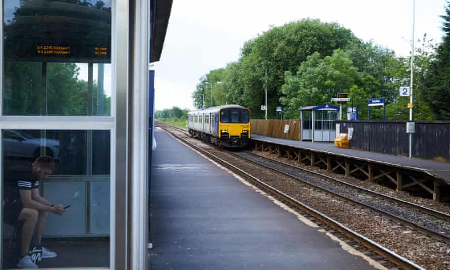 A Pacer train arriving at Smithy Bridge station.