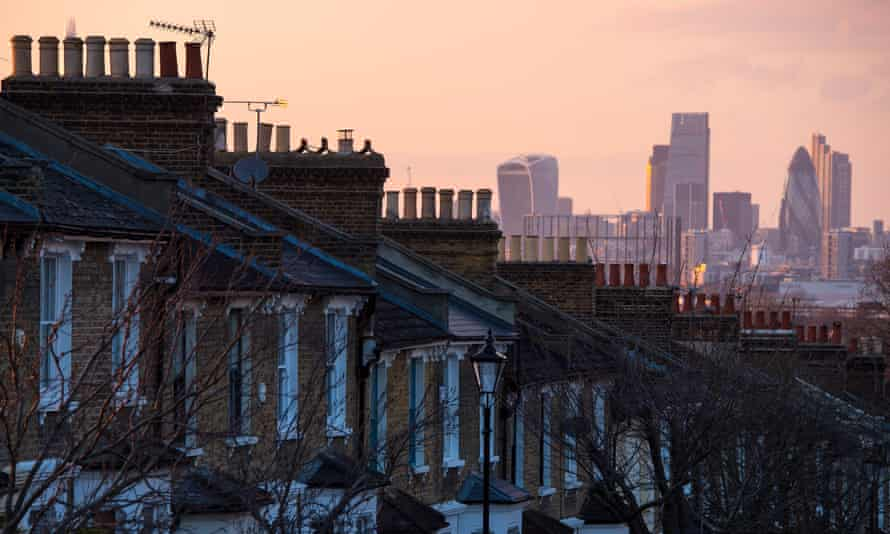 Houses in south London and the skyline of the City.