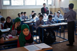 Girls attend classes at the Wesa Academy where they now make up more than a third of the pupils at Kandahar's first co-educational school.