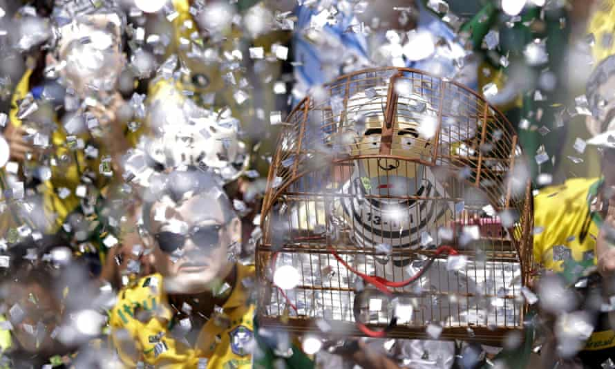 """An inflatable doll known as """"Pixuleco"""" of Silva is seen inside a cage during a protest in BrasiliaAn inflatable doll known as """"Pixuleco"""" of Brazil's former President Luiz Inacio Lula da Silva is seen inside a cage during a protest against Brazil's President Dilma Rousseff, part of nationwide protests calling for her impeachment, near the Brazilian national congress in Brasilia, Brazil, March 13, 2016. REUTERS/Ueslei Marcelino"""