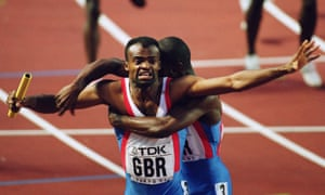 Kriss Akabusi is embraced by 4x400m teammate Derek Redmond after anchoring Britain to gold at the 1991 World Athletics Championships in Tokyo.