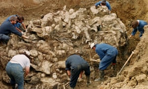 International criminal tribunal investigators at a mass grave near the village of Pilica, Bosnia-Herzegovina, in 1996, a year after the Srebrenica massacre.
