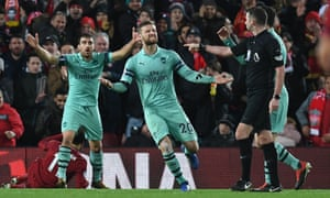 Mustafi and Sokratis complain to Michael Oliver about the award of the penalty.