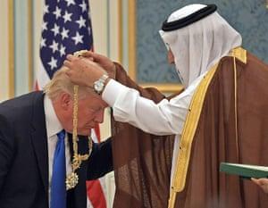 Donald Trump accepting a gold medal from King Salman of Saudi Arabia