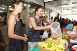 Locals buy fruit and veg at Rapid Creek market
