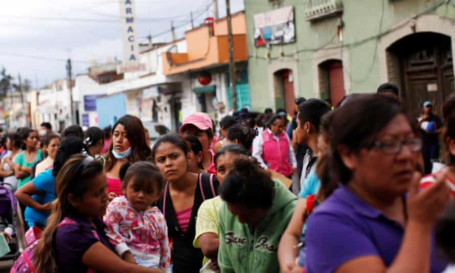 Residents queue for food at a collection center after the earthquake in Xochimilco.
