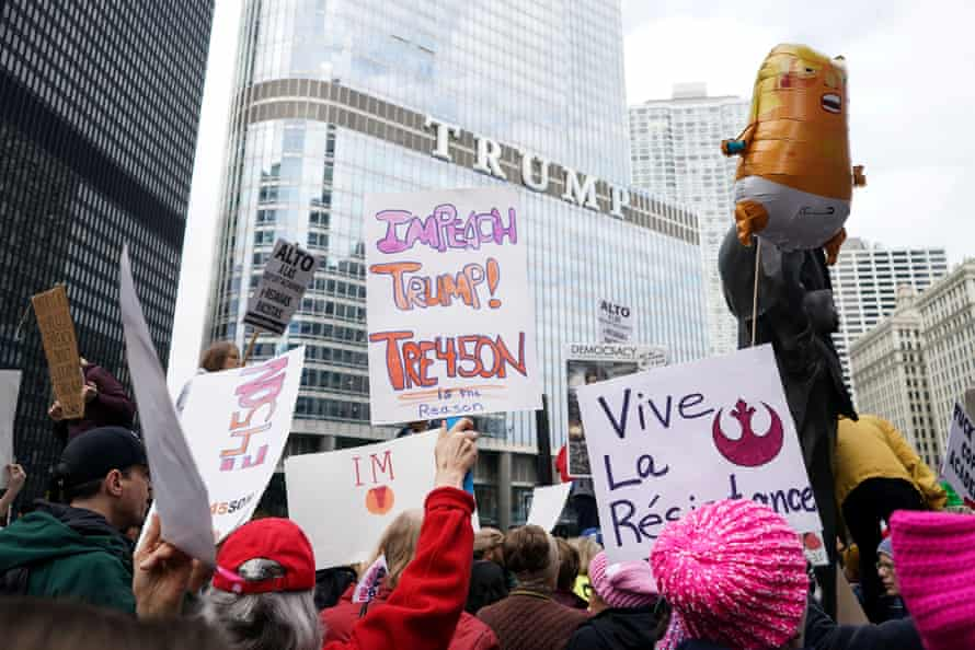 Demonstrators rally downtown during a protest against Trump's visit.