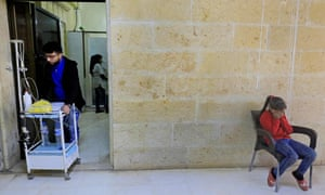 Girl cries in Afrin hospital