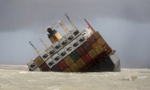 Large container ship tilting over in the water.