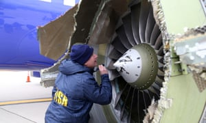 National Transportation Safety Board investigator Jean-Pierre Scarfo examines damage to the CFM56-7B engine on Southwest Airlines flight 1380.