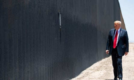Donald Trump stands near a border wall at the international border with Mexico in San Luis, Arizona, 23 June 2020.