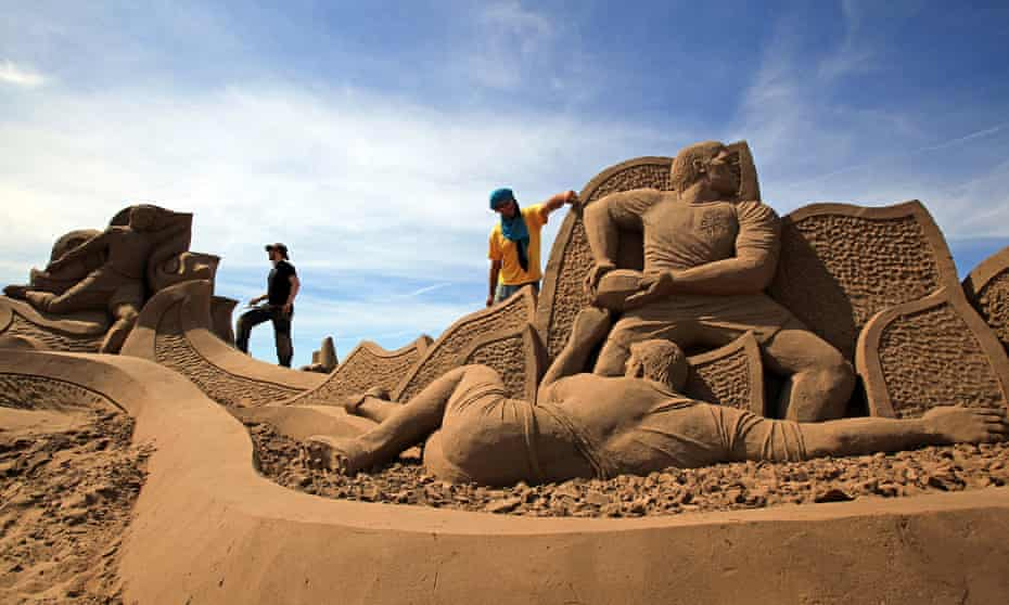 Artists put the finishing touches to their sand sculptures at the Weston-Super-Mare festival.