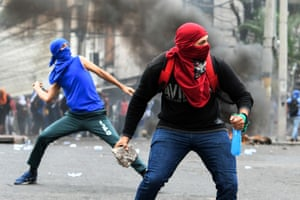 Tegucigalpa, Honduras. Students clash with riot police during a protest against the Honduran president, Juan Orlando Hernández, in the surroundings of the congress building