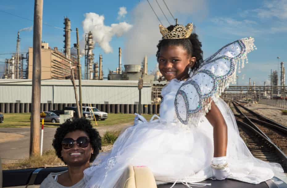 """Beauty Queen in a convertible riding in Norco's annual Christmas Parade in Norco Louisiana on Dec 6, 2015.. The parades theme for 2015 was """"Santa 4 President."""" Norco is in the middle of a stretch along the Mississippi Rive between New Orleans and Baton Rouge in Louisiana known to some as 'Cancer Alley' and to others as the """"Petrochemical Corridor."""""""