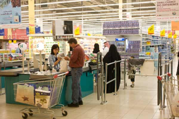 A supermarket in the capital, Doha. Women in Qatar can be asked to show their male guardian's permission to work even though it is not required by law.