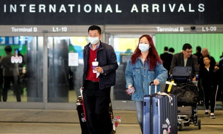 Passengers leave LAX after arriving from Shanghai, China, after a positive case of the coronavirus was announced in the Orange county suburb of Los Angeles Sunday.