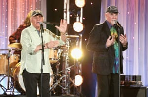 Musicians Bruce Johnston and Mike Love of The Beach Boys perform onstage during the Hollywood Walk of Fame Honors at Taglyan Complex on October 25 in Los Angeles.