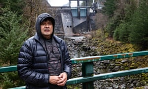 Scott Schuyler stands in front of the Gorge Dam, which diverts the entire Skagit River into a hydroelectric tunnel.