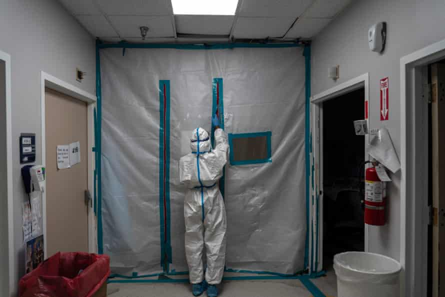 A medical staff member exits the Covid-19 intensive care unit at a hospital in Houston.