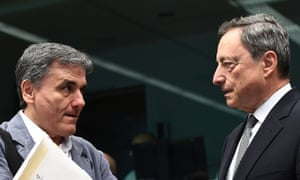 Greece's Finance Minister Euclid Tsakalotos speaking with European Central Bank President Mario Draghi during last night's Eurogroup finance ministers meeting.