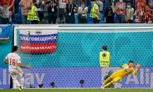 Yann Sommer of Switzerland saves the Spain third penalty taken by Rodri.