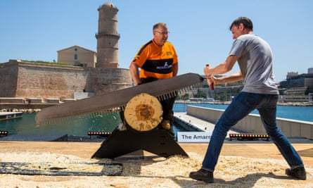 Tim Dowling is coached on the use of the single buck saw by Spike Milton in Marseille.