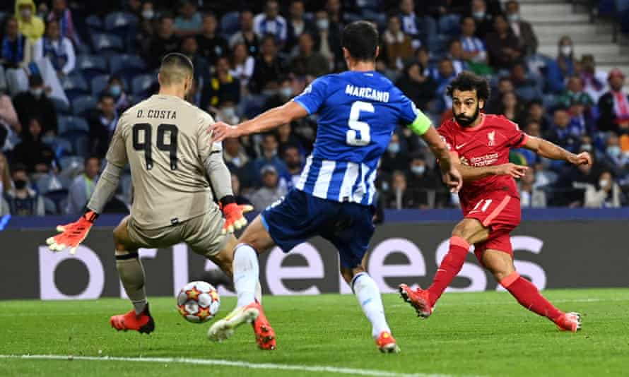 Mohamed Salah shoots and Diego Costa attempts to save in the match when Salah scored twice.