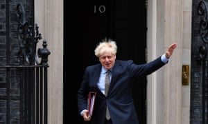 Boris Johnson waves as he leaves Downing Street