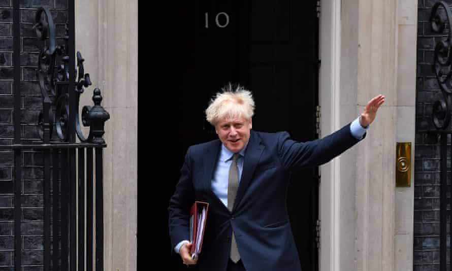 Boris Johnson waves as he leaves Downing Street