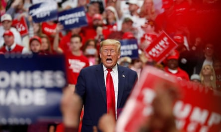 Donald Trump speaks at a campaign rally in Charlotte, North Carolina, on 2 March. He is due to resume rallies in Tulsa, Oklahoma, on Friday.